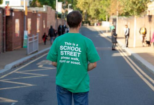 Person in school streets t shirt