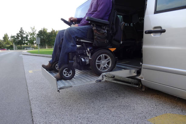 Person in wheelchair boarding a vehicle